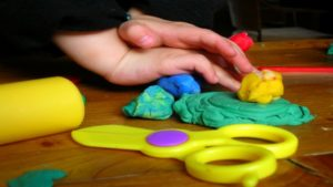 Childs Hands with playdough